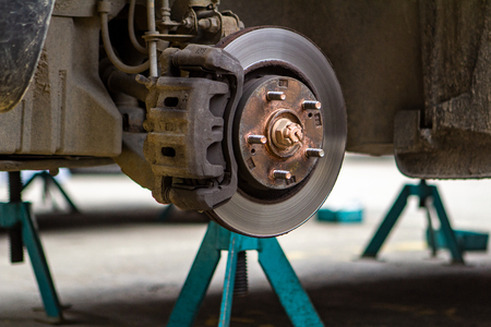 brake discs on the machine with the removed wheels on the jacks. wheel replacement