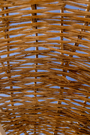 Wicker texture against the blue sky background