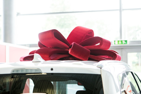 New car with red bow as present concept Reklamní fotografie