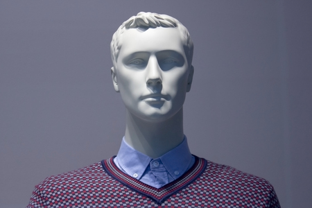 Head of a white mannequin man on a blue background