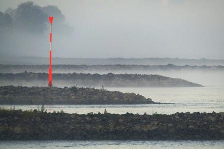 Low water in fog Standard-Bild - 116295713