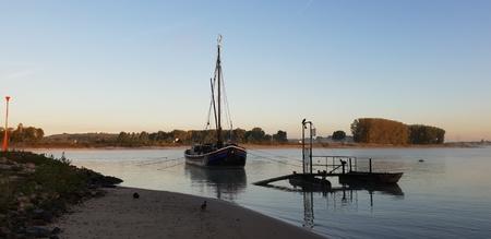 Ship on the river Standard-Bild - 116295787