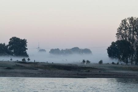 Mist on the river Standard-Bild - 116295869