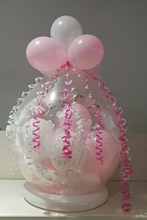 Gift balloon pink - white Standard-Bild - 116295958