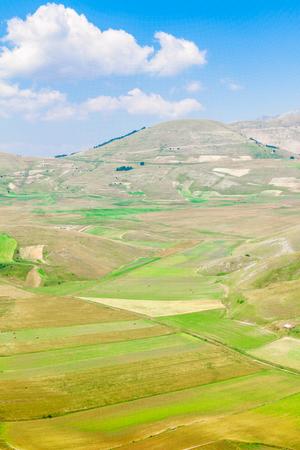 castelluccio di norcia: Cultivated fields and Monti Sibillini in Castelluccio di Norcia, Italy Stock Photo