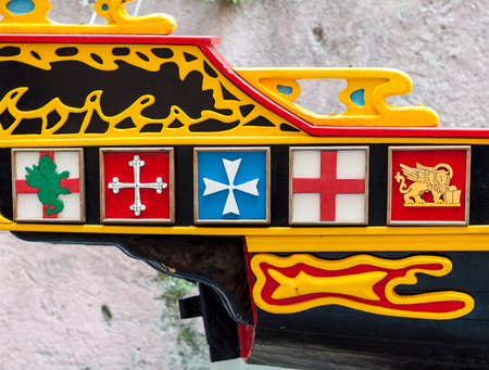 Ancient blazons on a boats stern