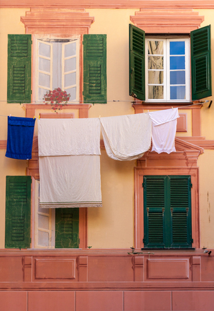 clothes hanging: Shutters, fake windows and clothes hanging on a mediterranean facade