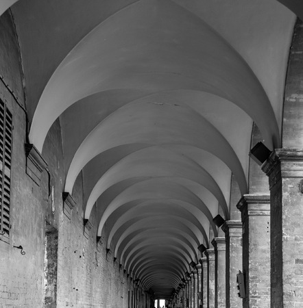 corridors: Covered columnade in Urbino. Vault Stock Photo