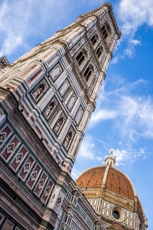 Cupola of Brunelleschi and Giottos tower Bell in Florence, Italy. From bottom angle. Summer day with some cloud Stock Photo