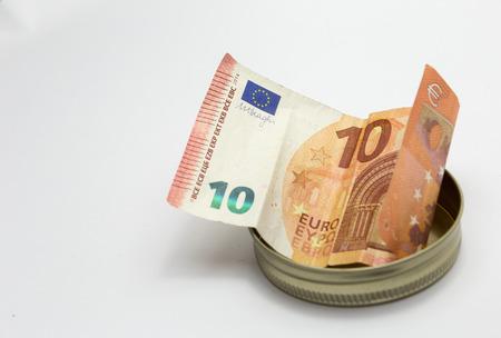 offering ten euros as tips Stock Photo