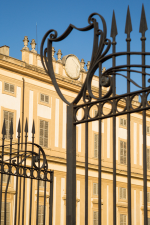 monza: Iron gate of Villa Reales gardens in Monza, Italy. Lombardy Editorial