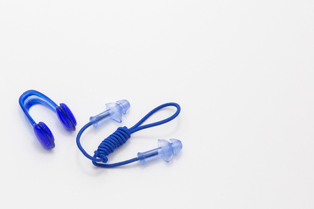 Nose clip and ear plugs for swimming pool on white background. Sport equipment, blue