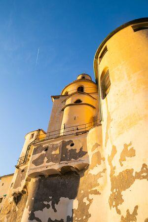 Basilica Santa Maria Assunta kissed by a warm winter sun in January. Camogli, Ligury. Italy Stock Photo
