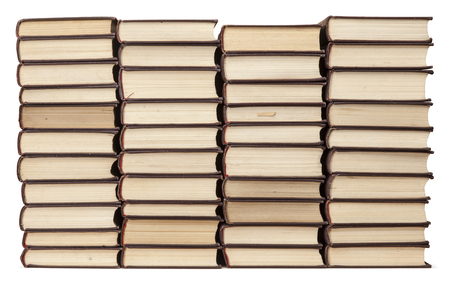 Stacks of old books with yellowed pages isolated on white background. Library or bookstore concept. Stockfoto