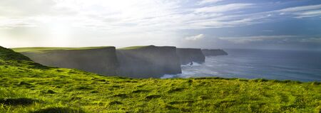 Cliffs of Moher Burren panoramic view, green grass, morming, County Clare, Ireland
