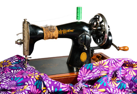 making dresses: old sewing machine and colored cloth for making dresses