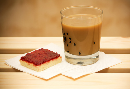breadcrumbs: coffee with milk and cranberry cake on wooden table Stock Photo