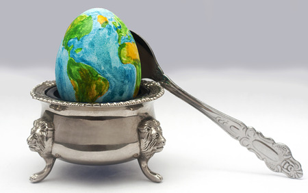 the earth in the image of the egg lies on a plate before dinner time