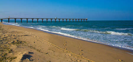 A view on a coastal strip with a wharf