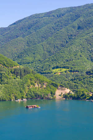 A view on the Vacha lake in Rodopi mountains in summertime photo