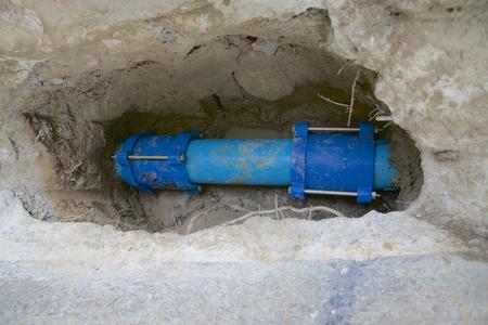 unearth: Underground Water Pipe Repair Stock Photo