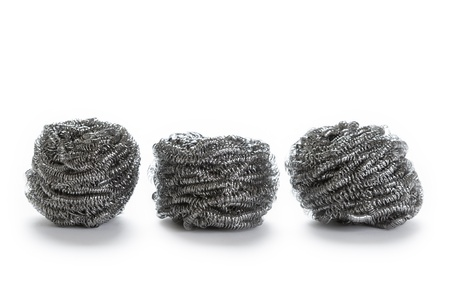 scouring: stainless steel pan scourers on white background
