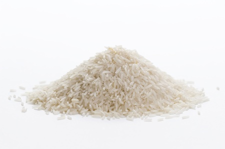 uncooked basmati rice in a small pile on a white background 版權商用圖片