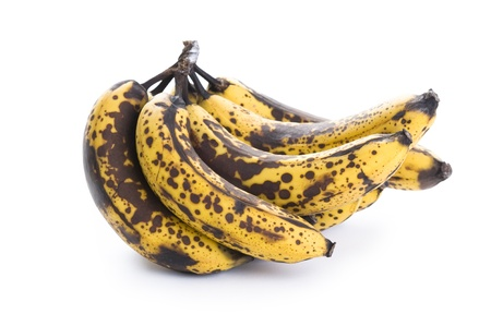 over ripe, overripe, over-ripe bunch of bananas isolated on a white background
