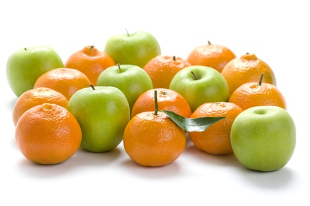clementine oranges and granny smith apples isolated on a white background Imagens