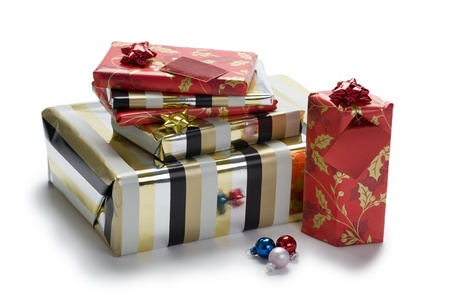 a pile of wrapped Christmas or Xmas gifts or presents isolated on a white background Stock Photo - 11955451