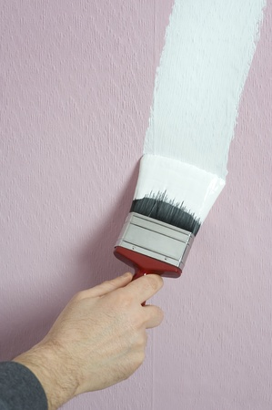 man decorating or painting with a paint brush photo