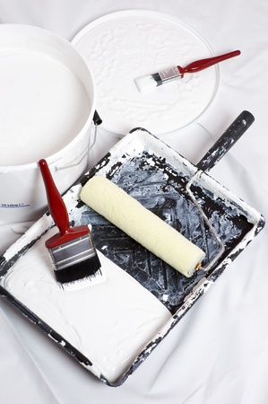 paint brushes and roller of a home decorator photo