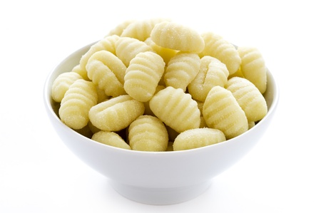 uncooked gnocchi in a white bowl isolated on a white background 版權商用圖片