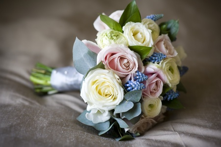 bouquet of spring flowers including: roses, muscari and ranunculus photo