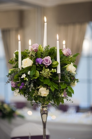 center piece table decoration with candles and flowers photo