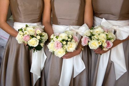 bridesmaids holding bouquet of flowers at a wedding photo