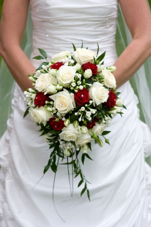 bride holding a bouquet of flowers on her wedding day photo