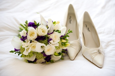 wedding shoes and flowers of the bride photo