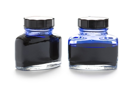 two and a half: two bottles of blue writing ink one half empty Stock Photo