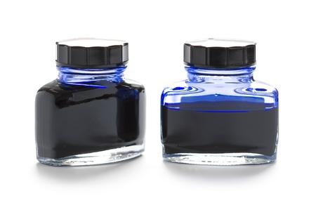 two bottles of blue writing ink one half empty 版權商用圖片