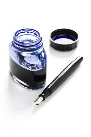 fountain pen writing: fountain pen, bottle of blue ink and lid
