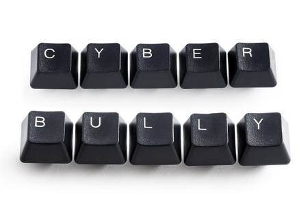 cyber: computer keys spelling cyber bully Stock Photo