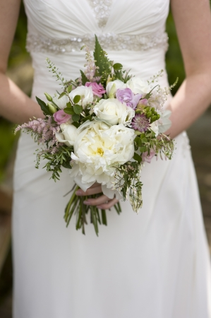 bride holds a bouquet of wedding flowers Stock Photo - 13604958