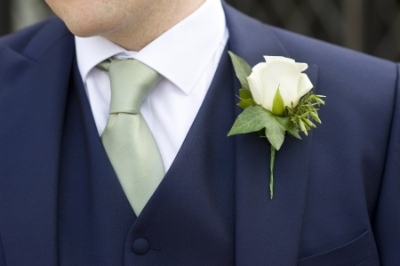 buttonhole: man at a wedding wearing a floral buttonhole