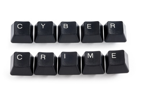 internet fraud: computer keys spelling the words cyber crime