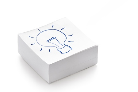 lightbulb drawing on a stack of post it notes illustrating the concept of having an idea