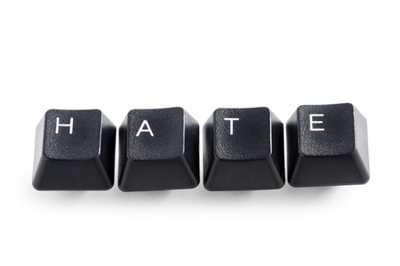 trolling: computer keys isolated on white spelling the word  hate