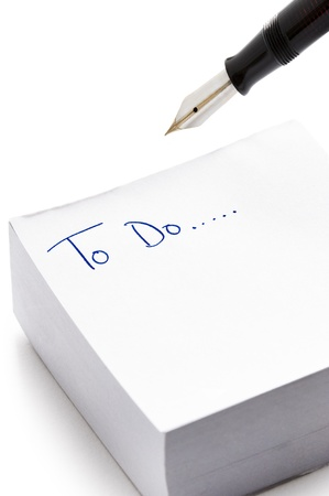 postits: post it pad with the words to do written in ink Stock Photo