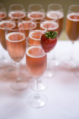 glasses of pink champagne with strawberry