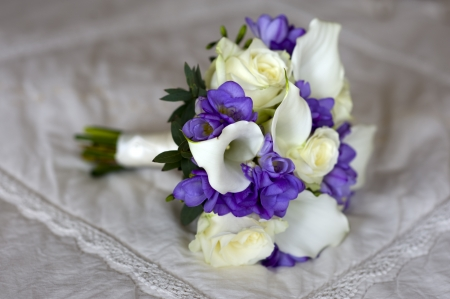wedding bouquet of freesia, lilies and roses in white and purple photo
